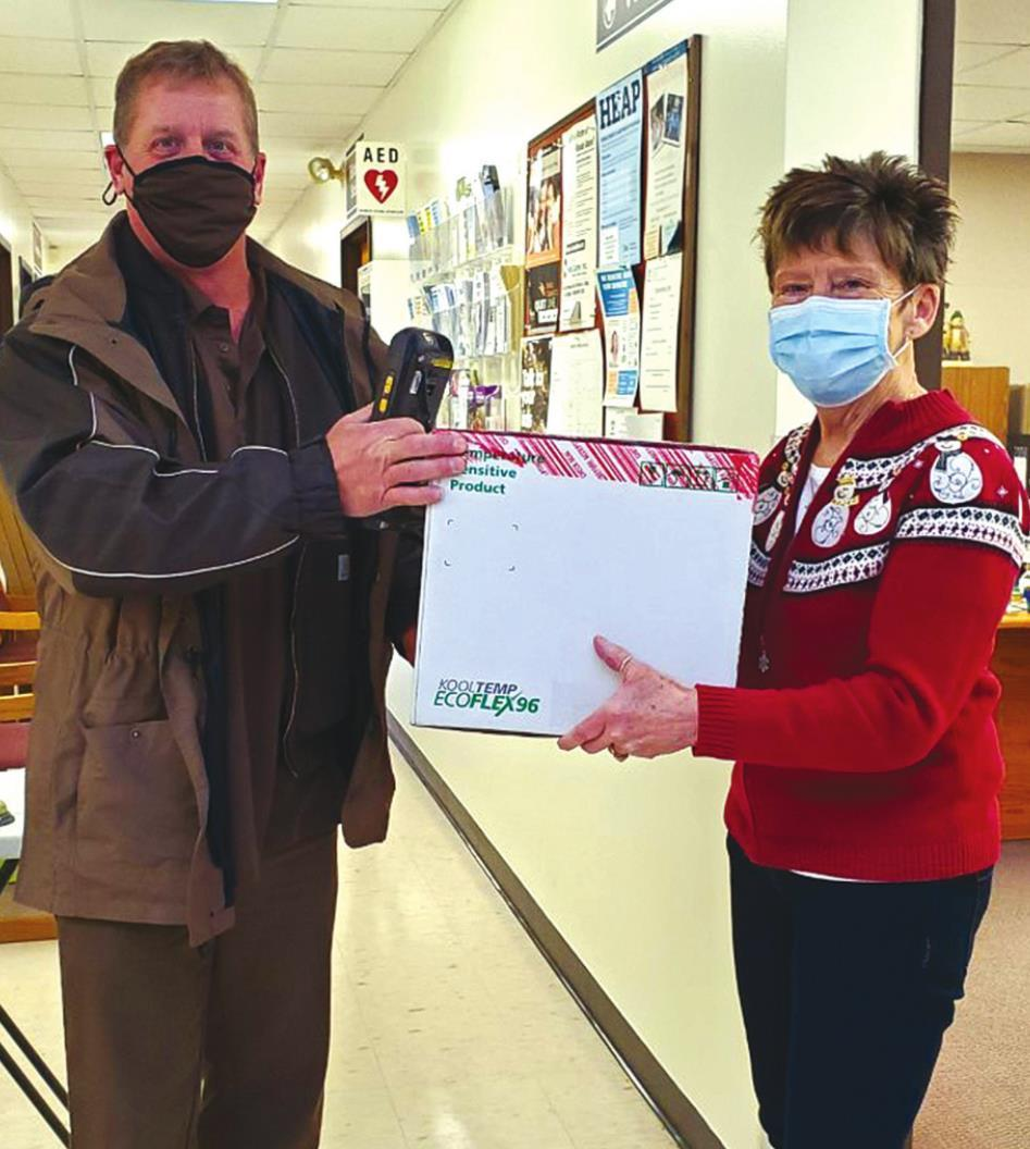 UPS driver John Edwards delivers the first shipment of vaccines to Monroe County Health Director Linda Dick Tuesday, Dec. 22 at the Monroe County Health Department.