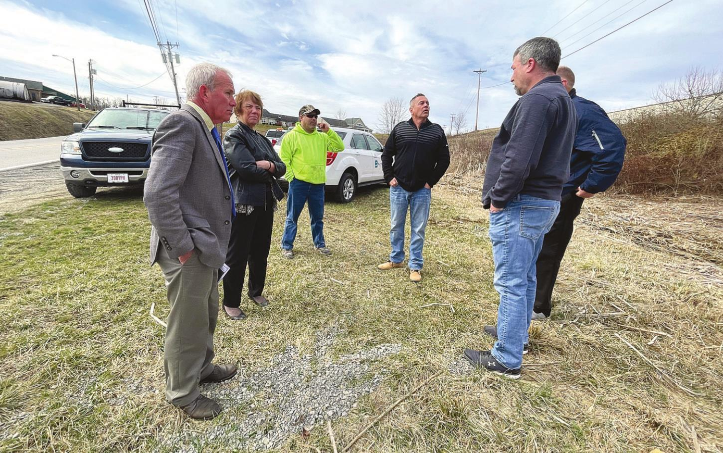 The Monroe County Commissioners work with village staff and representatives from E.L. Robinson to find a suitable location for a screen to catch debris Monday, March 15 near the Monroe County Jail off Moore Ridge Road in Woodsfield. Pictured are, from lef