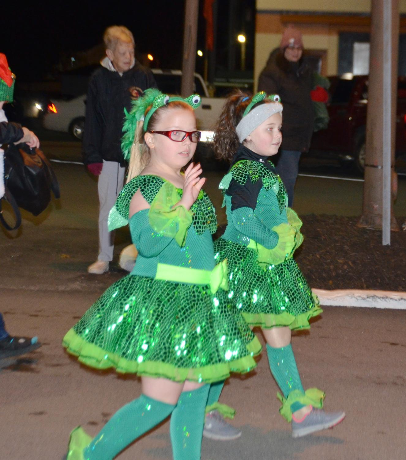 The dancers from K. Lynn Dance Studio wave to the crowd during the annual Christmas Parade.