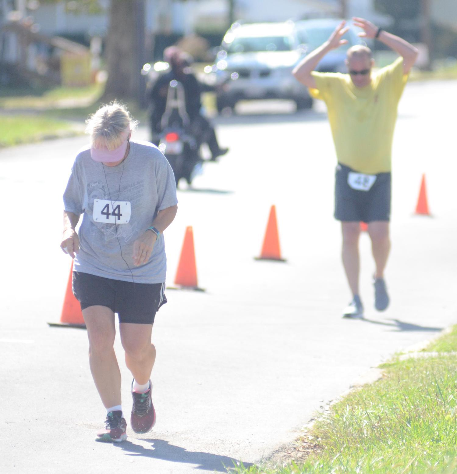Lori Michener and John Zerger brave the bright sunshine during a lap of Charlie's Run Saturday, Oct. 5 in Woodsfield.