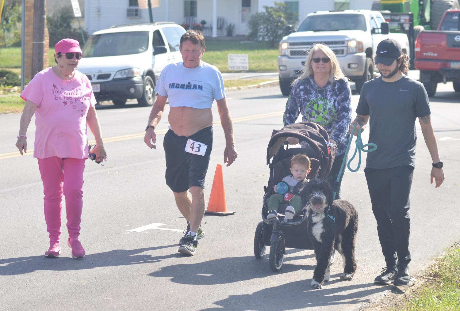 Mitch Toto, second from left, one of the founders of the annual Children's Hospital Charity Run, does a lap of Charlie's Run with four generations of his family. Pictured are, from left to right: Nancy Toto, Mitch Toto, their daughter Christine Nichol