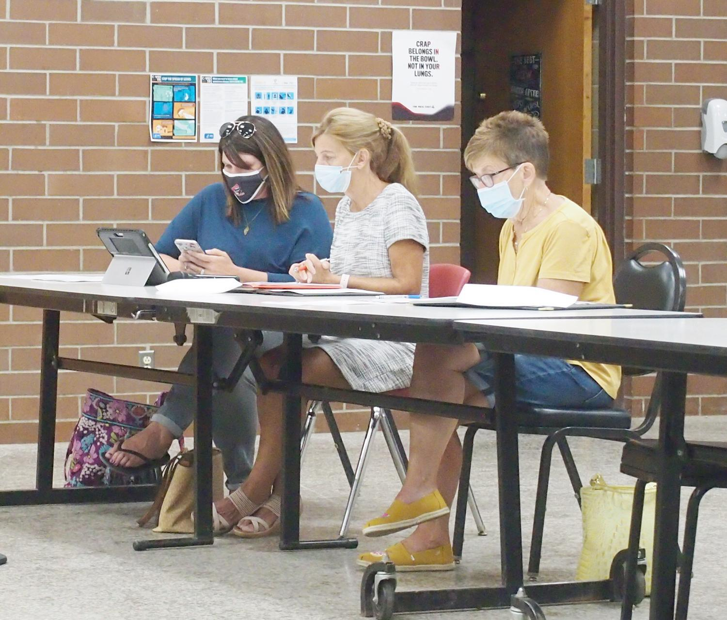 District Health and Safety Committee Chair Lydia Brodegard, left, researches a question about the health and safety portion of the district's draft plan for fall school reopening Thursday, July 23 at Swiss Hills Career Center.